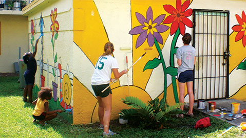 Students painting wall flowers2