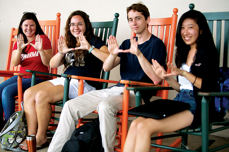 UM students rock! Students in rocking chairs.