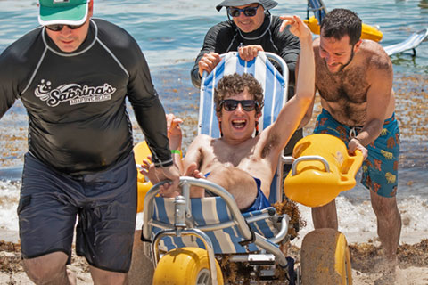 Volunteers from the Miller School of Medicine Department of Physical Therapy and others help people with special needs enjoy the ocean from April to November.