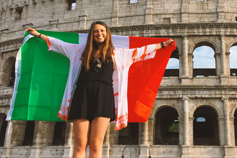 UM alumna Jessica Bekoff stands in front of the Colosseum during her semester in Rome, Italy