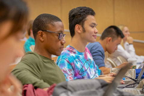 Students listen to Professor Mitsunori Ogihara during an Introduction to Programming lecture.