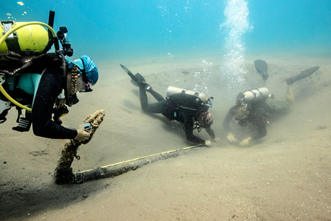 Divers with the research team explore the centuries-old anchor located off the coast of Mexico.
