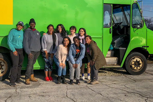 Students participating in the University of Miami Alternative Breaks Program pose by a truck near the Urban Growers Collective in Chicago, Illinois.