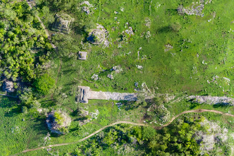 Built at the turn of the 7th century, the white plaster-coated road that began 100 kilometers to the east in Cobá ends at Yaxuná's ancient downtown, in the center of Mexico's Yucatan Peninsula. Photos and drawing courtesy of Traci Ardren/University of Miami