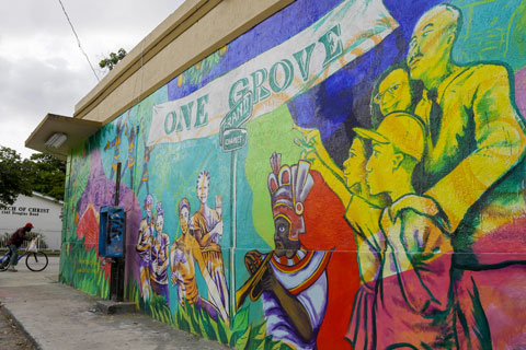 A mural promoting the Bahamian heritage of the Village West neighborhood of Coconut Grove in Miami is shown on the outside wall of a grocery store. The community was settled by Bahamian immigrants in the 1880s. Photo: Associated Press