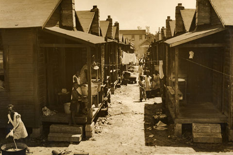 "This 1940s photo from the University of Miami Libraries' Florida Photograph Collection shows ""shotgun shacks"" where residents of Miami's Overtown neighborhood lived."