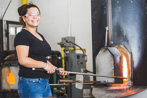Kim Diaz in the glassblowing studio.