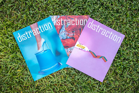 "The fall, winter, and spring printed issues of Distraction were named ""Magazine of the Year"" in the overall design category by the annual Michigan State University Design Contest for College Students."