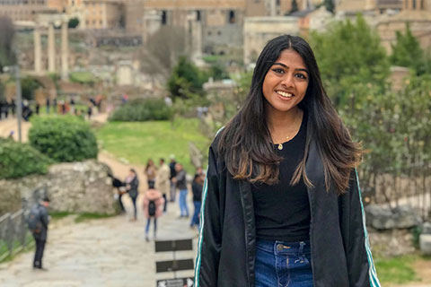 With the Arch of Titus captured in the background, Renu Nargund stands smiling during her 2019 spring break in Rome, Italy.