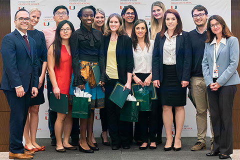 Competitors celebrate after presenting their research at the Three Minute Thesis Competition, hosted by the University of Miami's Graduate School.