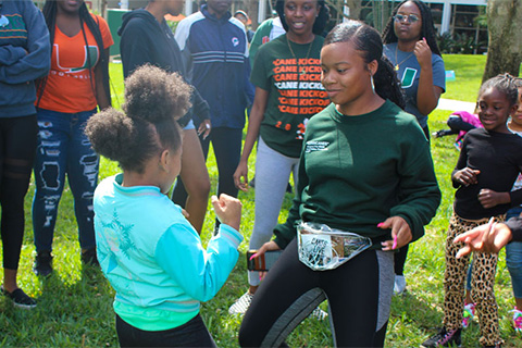 University of Miami students celebrated a fun day with grade-schoolers with Streamline Miami, working on  projects and other activities.